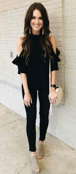 cold black shoulder blouse with narrow pants and gray short boots with open toes