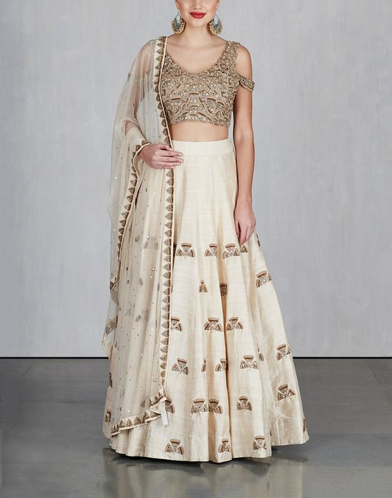 Off White Ginkgo Lehenga with Cold Shoulder blouse and dupatta .
