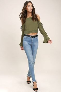 olive green long-sleeved top with cold shoulder and light blue jeans