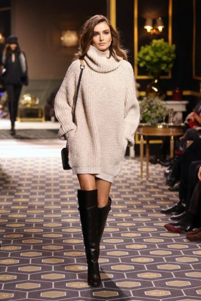 Knitted sweater dress with a cowl neckline, knee-high boots