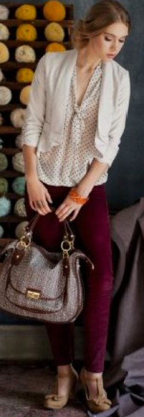 cream and black polka dot blouse with tie neck and light pink blazer