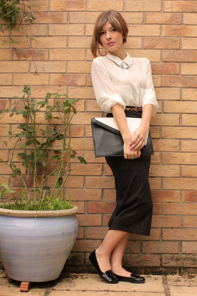 Cream-colored shirt with buttons and black, straight midi dress