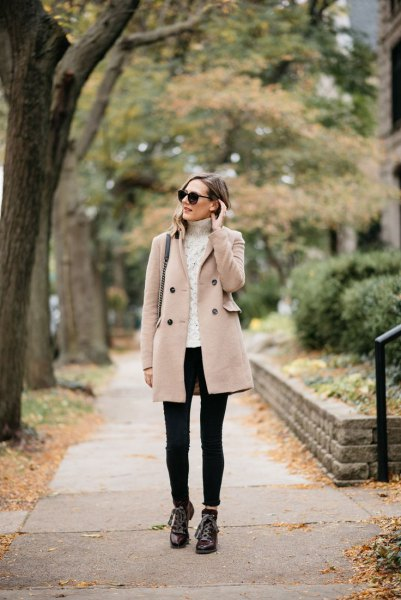 cream-colored cable knit sweater, black hiking boots