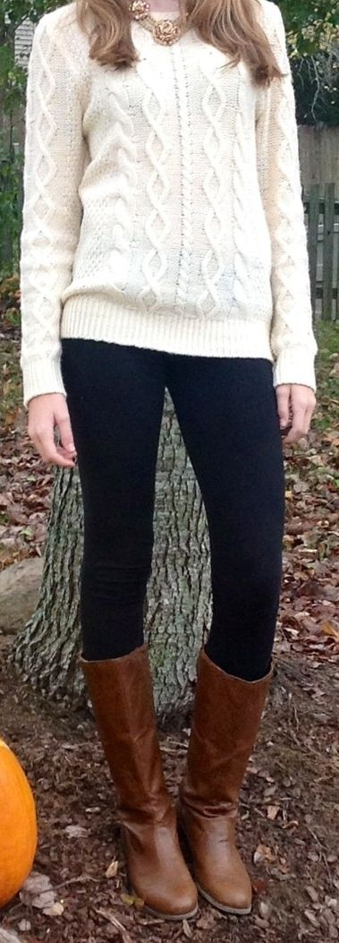 cream-colored calbe knit sweater, black skinny jeans