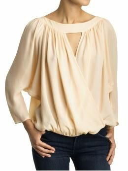 cream-colored keyhole blouse with black skinny jeans