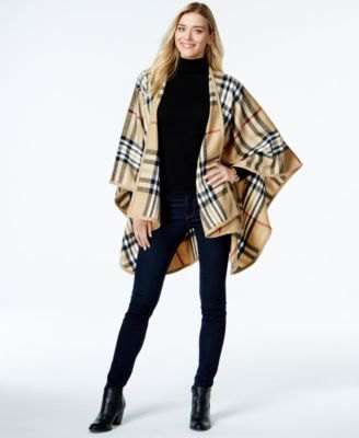 Crepe and black checked poncho turtleneck with a figure-hugging fit