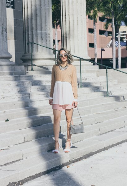 Short crepe sweater over a long white blouse