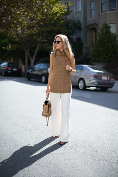 Tunic sweater with turtleneck and white trousers with wide legs
