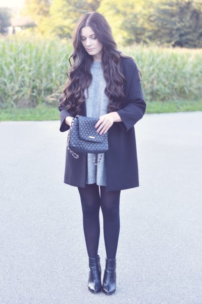 Crew neck sweater dress, black wool coat and leather boots