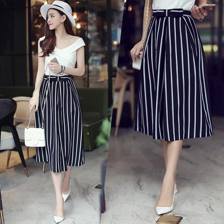 short-cut black and white striped trousers with wide legs and a white felt hat
