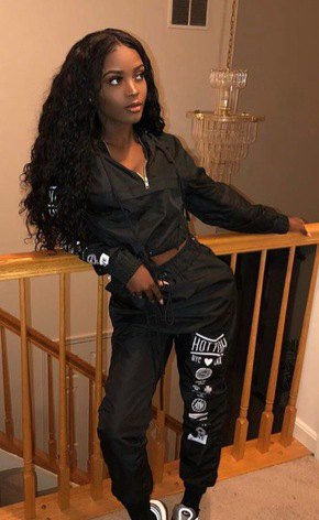 short black windbreaker with graphic jogger pants