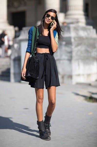 short blue cardigan with black crop top and minirater skirt