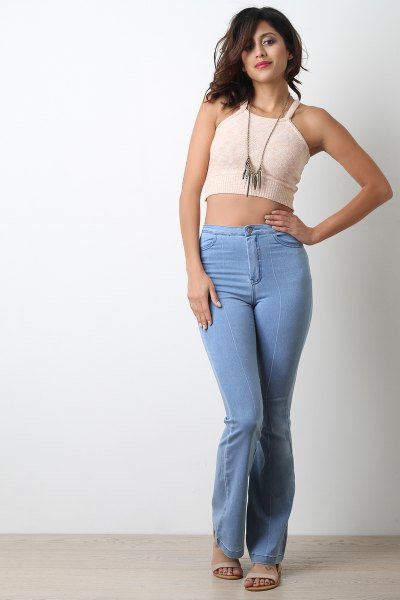 Short cut, light pink vest top with light blue high-rise jeans