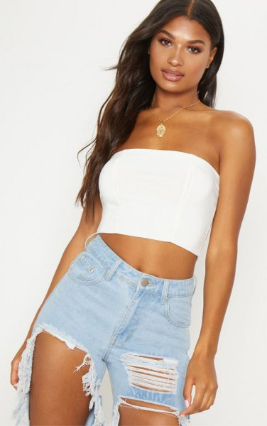 short tube top with badly torn boyfriend jeans