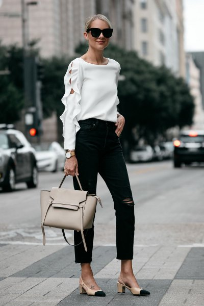 Neckline white sweater with ankle black jeans and pink heels