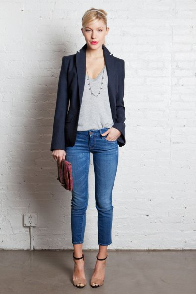 dark blazer with gray t-shirt with deep scoop neck and short jeans