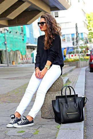 dark blue and white low shoes with white slim fit jeans