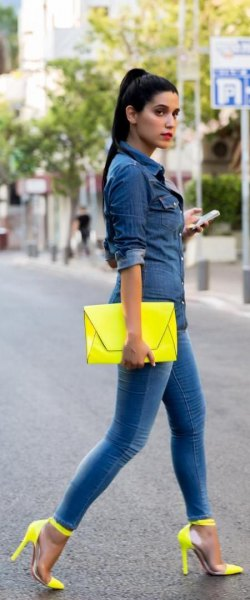 dark blue chambray shirt with buttons, yellow clutch and matching high heels