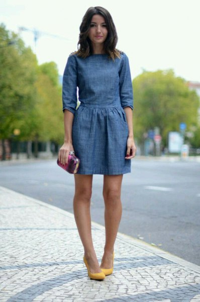dark blue mini denim dress with a gathered waist and mustard heel