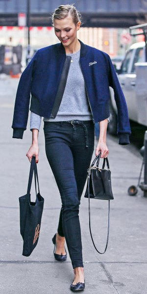 dark blue jacket with gray sweatshirt and high waisted jeans