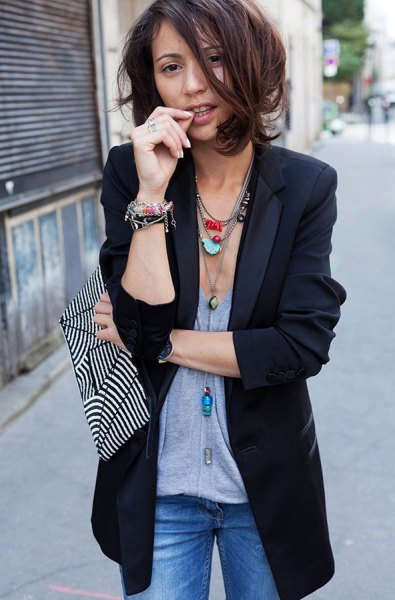 dark blue longline blazer with gray top and boho necklace