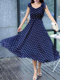 Dark blue maxi dress with a dotted fit and a flared maxi dress with silver heels