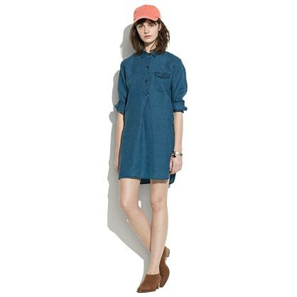 dark blue tunic with unwashed collar and baseball cap