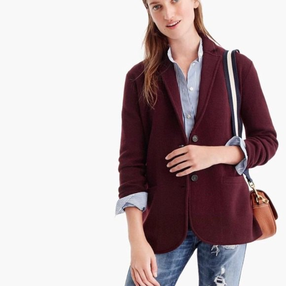 dark brown pullover blazer with a blue and white striped shirt with buttons
