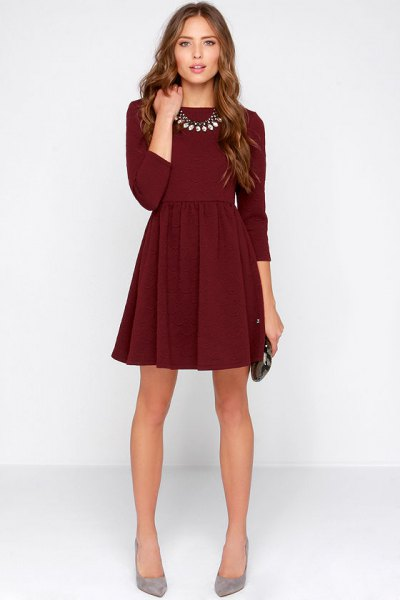dark burgundy mini dress with three-quarter sleeves and gray heels