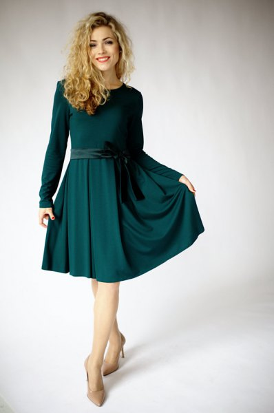 knee-length, flared dress with a dark green belt and long sleeves
