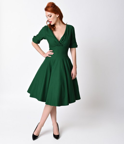 dark green swing dress with deep V-neck in the style of the 1950s