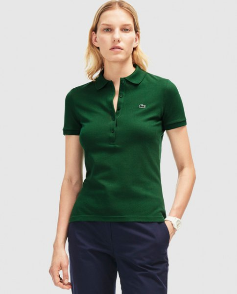 Dark green slim fit polo shirt with black chinos with a relaxed fit