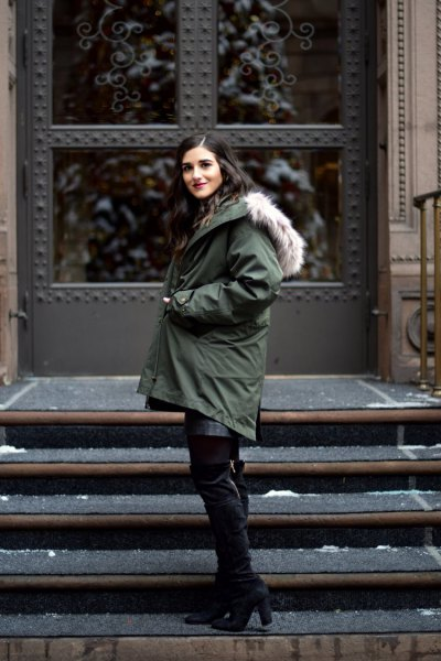 dark gray coat with black, thigh-high suede boots