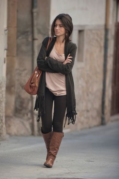 dark gray cardigan with fringes, light pink top with scoop neckline and brown leather boots