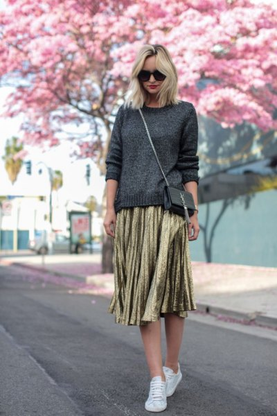 dark gray knitted sweater, gold pleated skirt