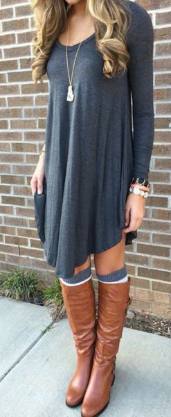 dark gray long-sleeved swing dress with brown leather boots