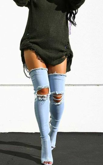 dark gray, torn sweater dress with long, open toe boots made of blue denim