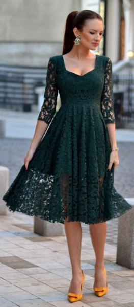 dark gray three-quarter-sleeved lace dress and flared midi dress with yellow heels