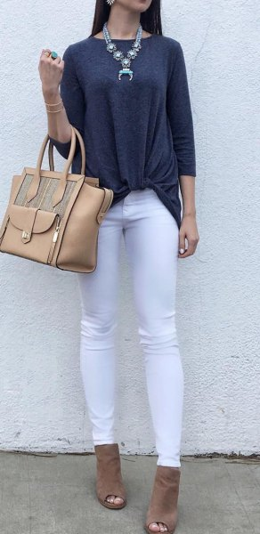 dark gray three-quarter top with white jeans and open toe boots