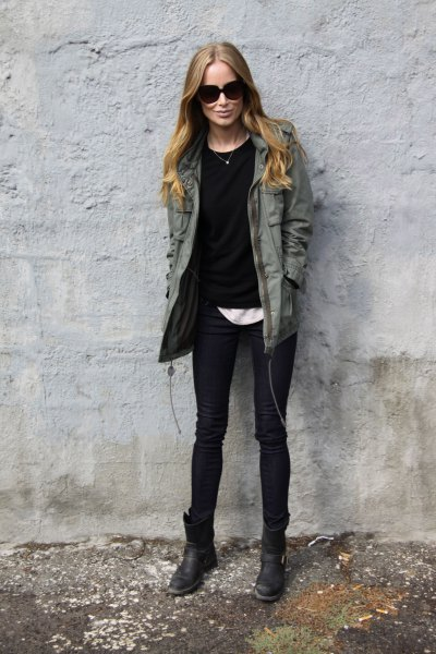 dark gray utility jacket with black sweater and white t-shirt