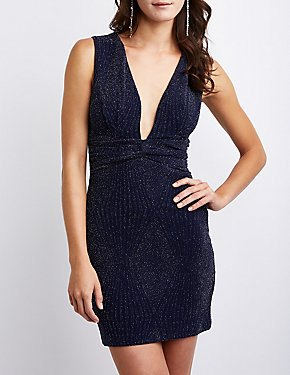 dark blue, deep, figure-hugging dress with deep V-neckline