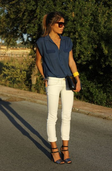 Dark blue sleeveless blouse with white jeans with cuffs