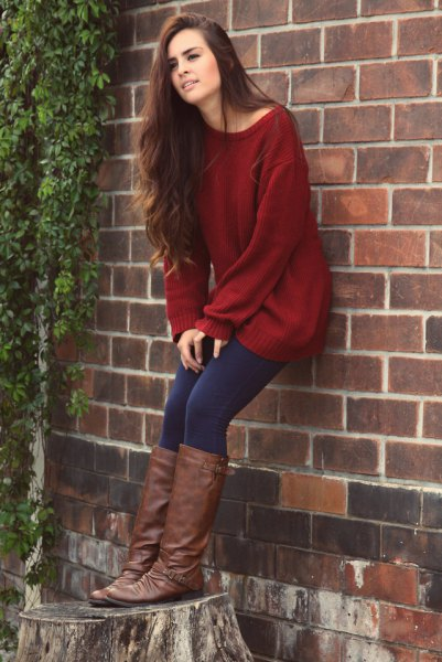 Dark red tunic sweater with boat neckline, dark blue leggings and knee-high boots