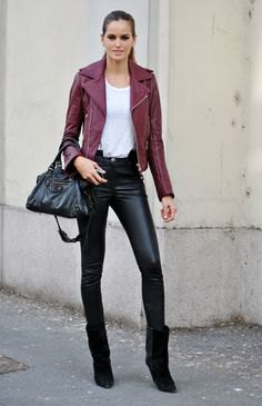 Dark red leather jacket with white tank top and black moto leggings