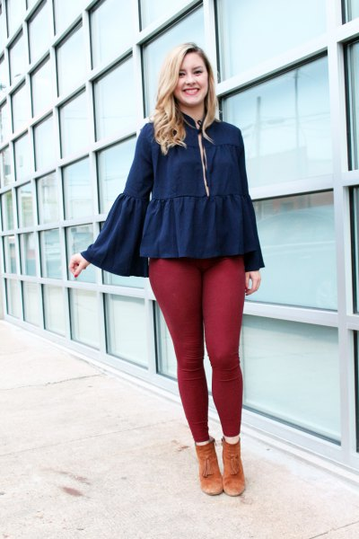 deep blue ruffled blouse with bell sleeves and green leggings