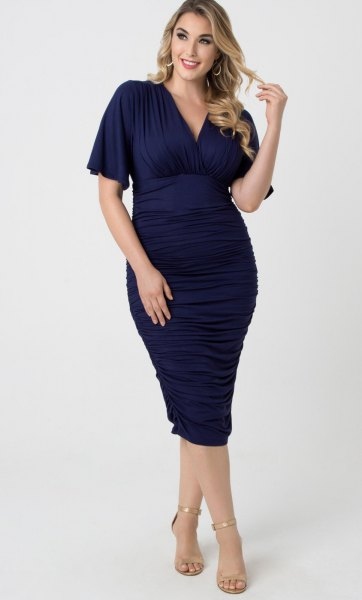 deep blue, figure-hugging midi dress with V-neckline and open toes