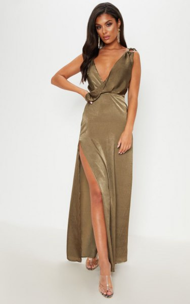 deeply slit khaki maxi dress with deep V-neckline and silver, open toe heels
