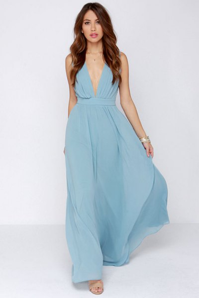 Light blue maxi dress with deep V-neckline and silver necklace