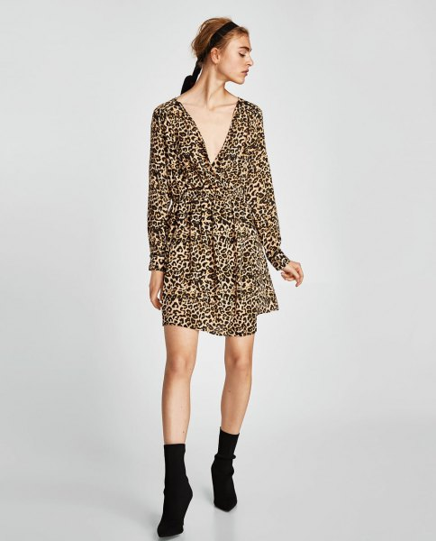 long-sleeved swing dress with a deep V-neckline