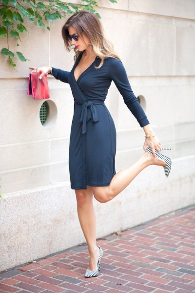 Midi wrap dress with deep V-neckline and pink clutch